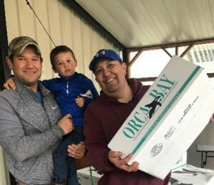 Salmon is distributed to a young family in Craig. Photo courtesy of President Clint Cook, Craig Tribal Association.